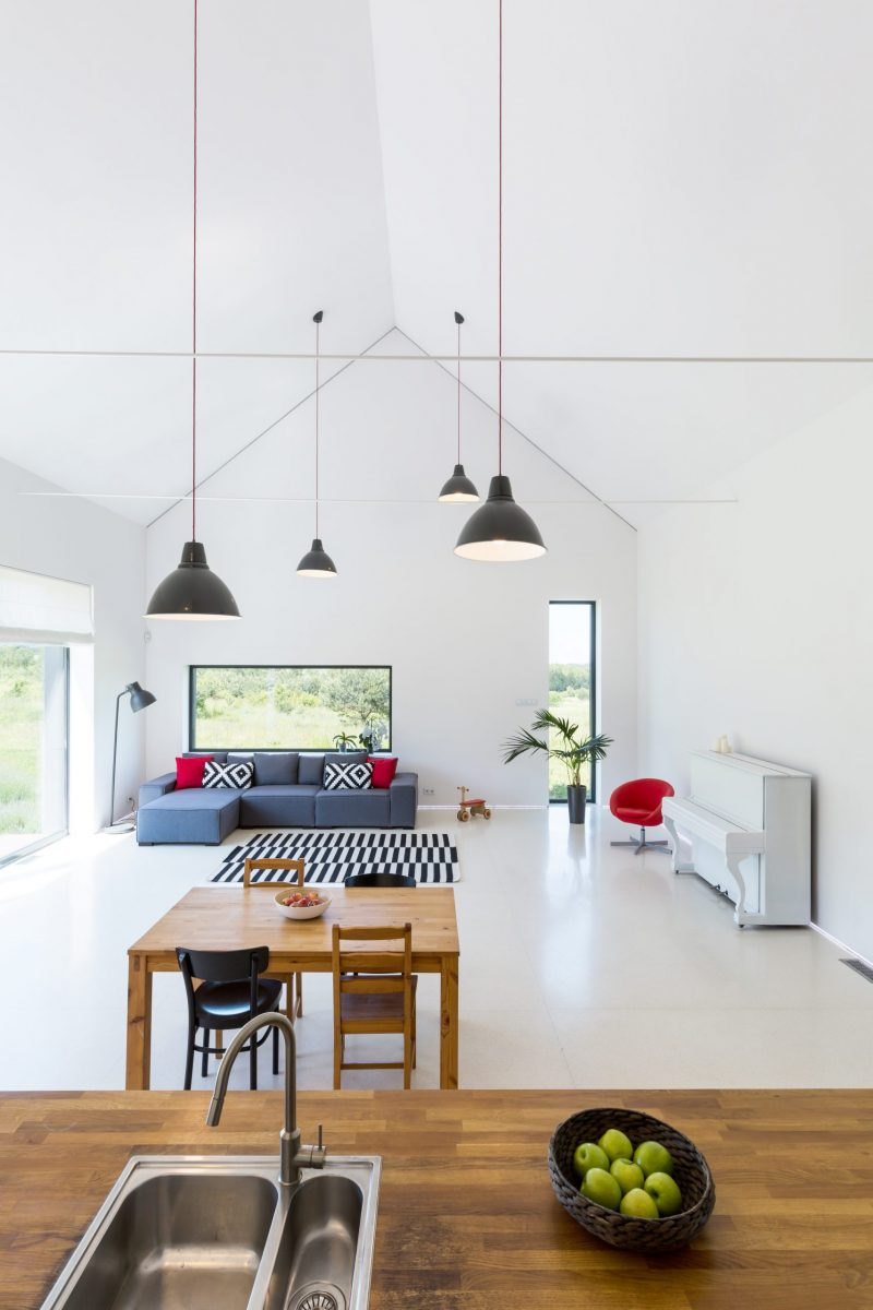 Interior of a detached house of a very modernistic shape and white walls, ceiling and floor